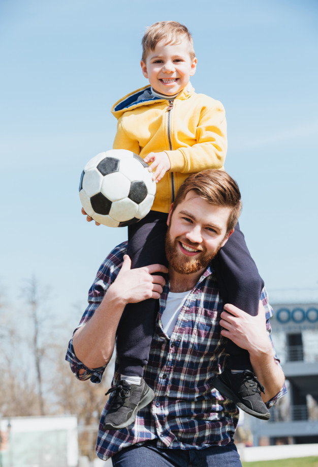 happy-father-carrying-his-little-son-shoulders_171337-16352